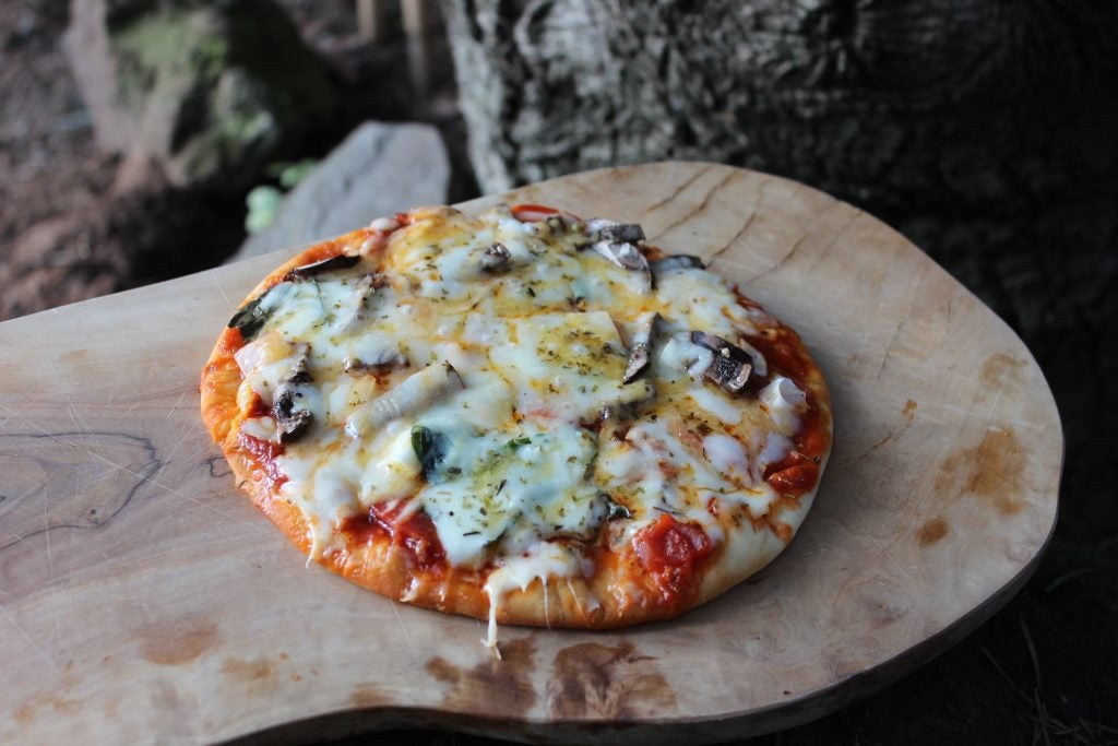 Put your kiddos to work making this kid friendly camping pizza recipe!