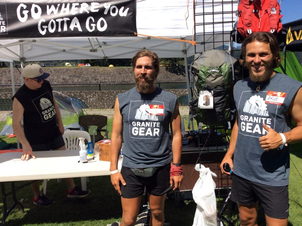 """The Granite Gear booth: a """"show don't tell"""" experience. The Packing it Out guys have 1000s of lbs of trash behind them backing up their partnership with Granite Gear. It's always impressive to see partnerships that do so much good in the world."""