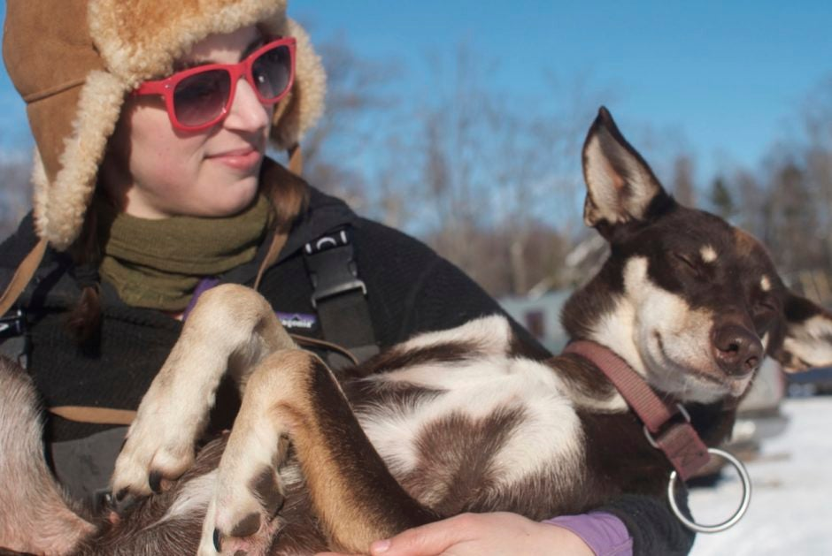 a dog sled racer and her pup