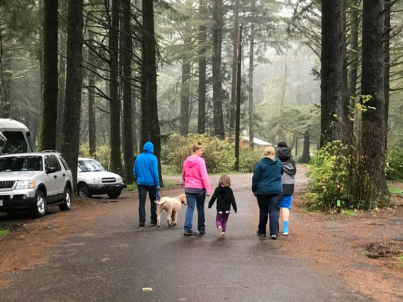 family walking through forest of Beverly beach State Park, a tent and RV campground in Oregon