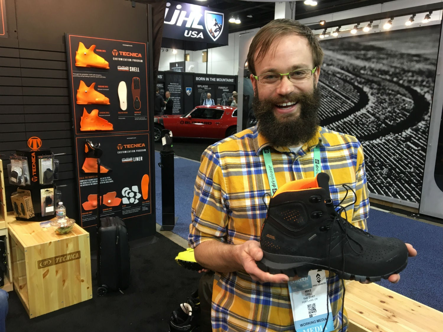 holding tecnica's custom boots at outdoor retailer