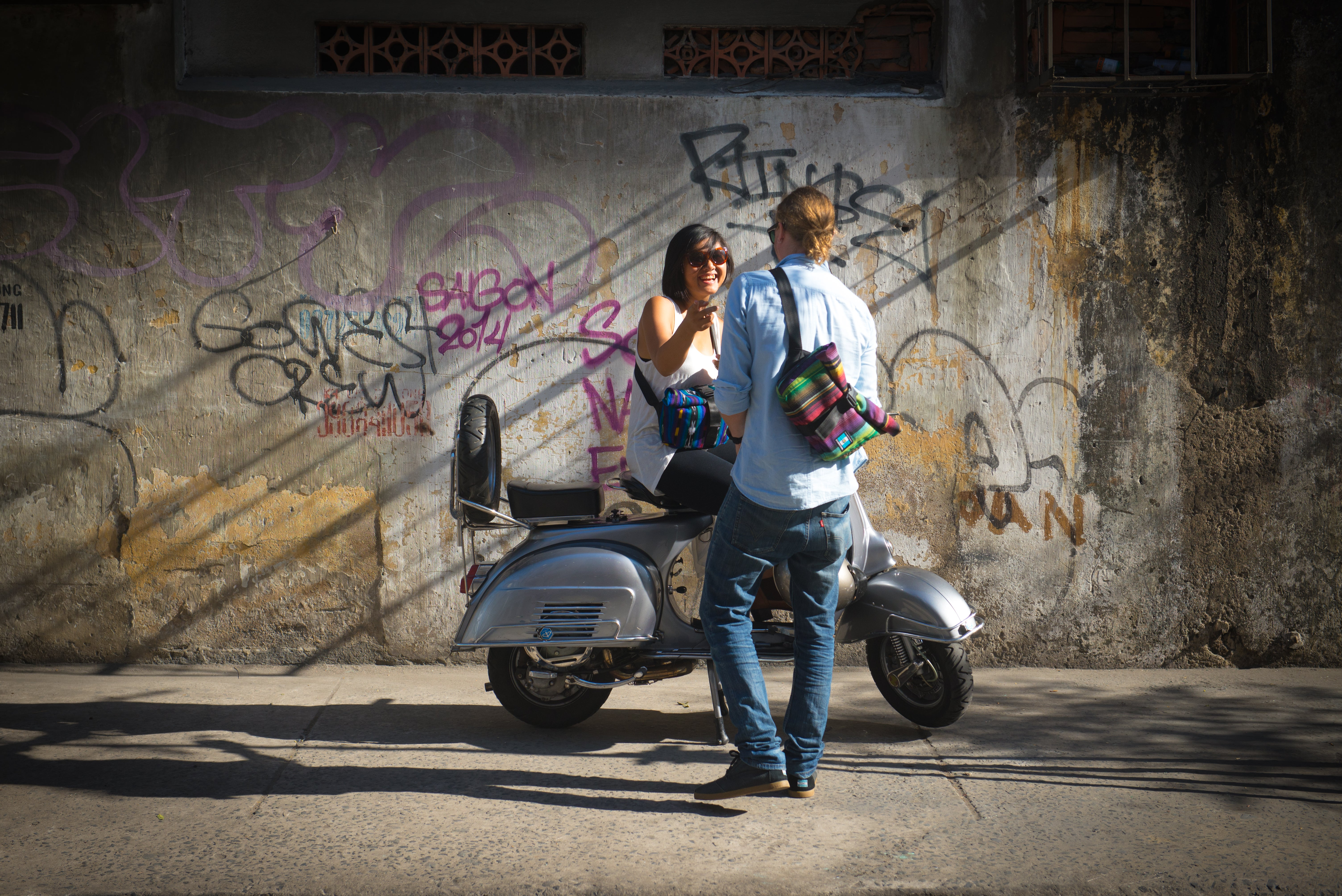 cyclo travel sling two people on moped