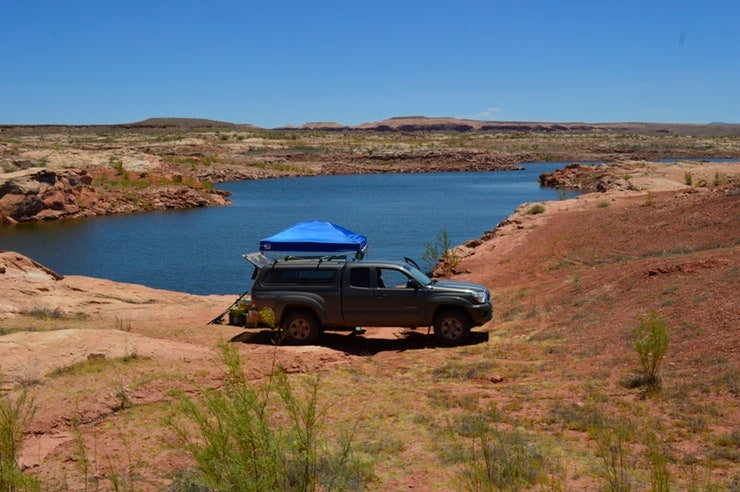 truck overlooking desert river on a planned camping trip