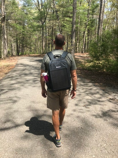 walking with a solar charger backpack