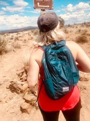 sarah testing out her ultralight backpacking pack