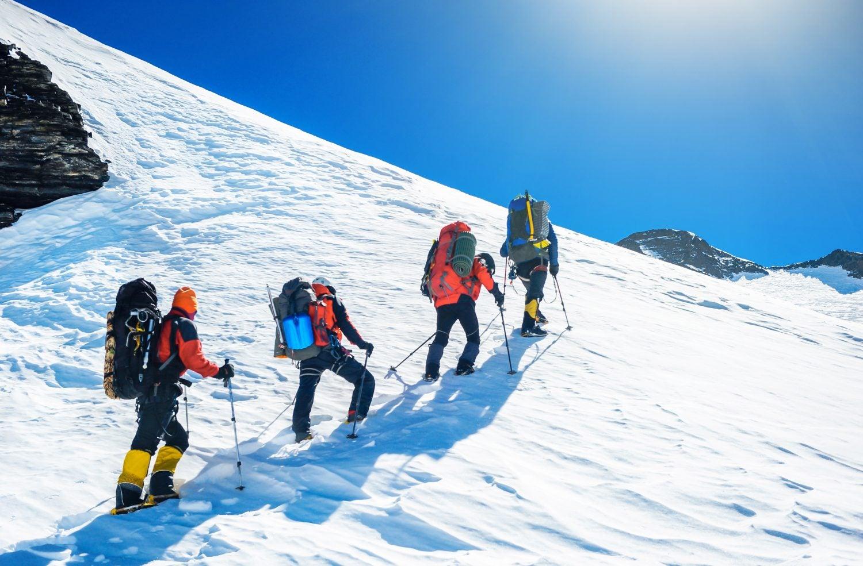 mountaineering through the snow