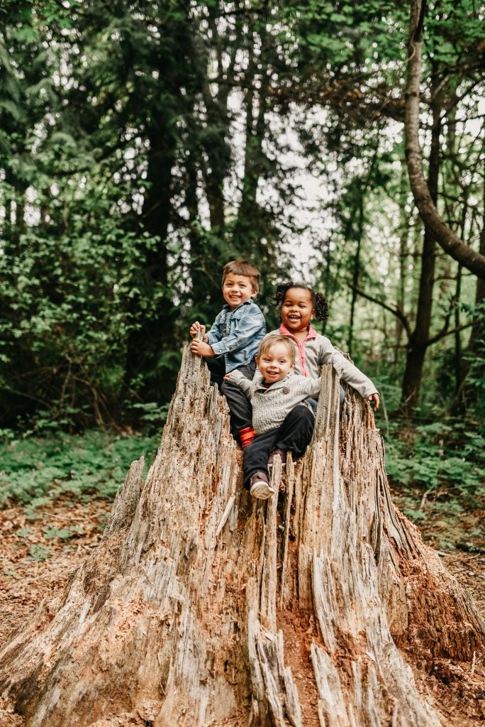 three young kids playing in hollow tree stump, via hike it baby
