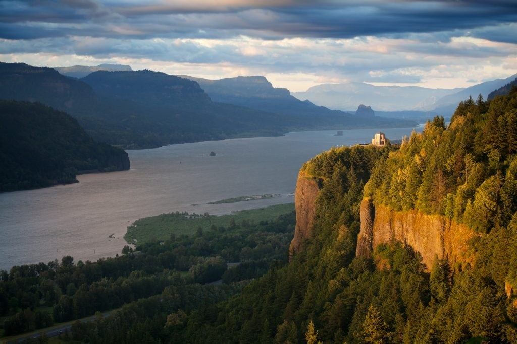 the columbia river gorge near portland oregon at sunset, the vista house is in view