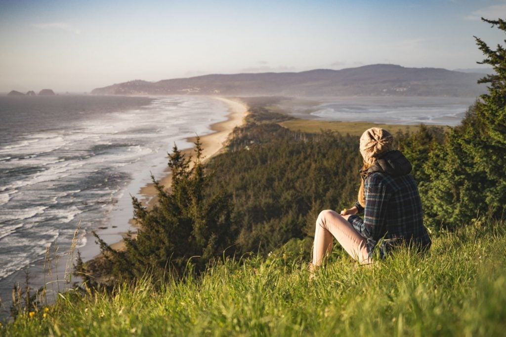 Person enjoying sunset at Cape Lookout, Oregon Coast
