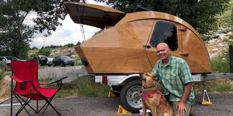 Art and his dog Dakota in front of their homemade teardrop camper