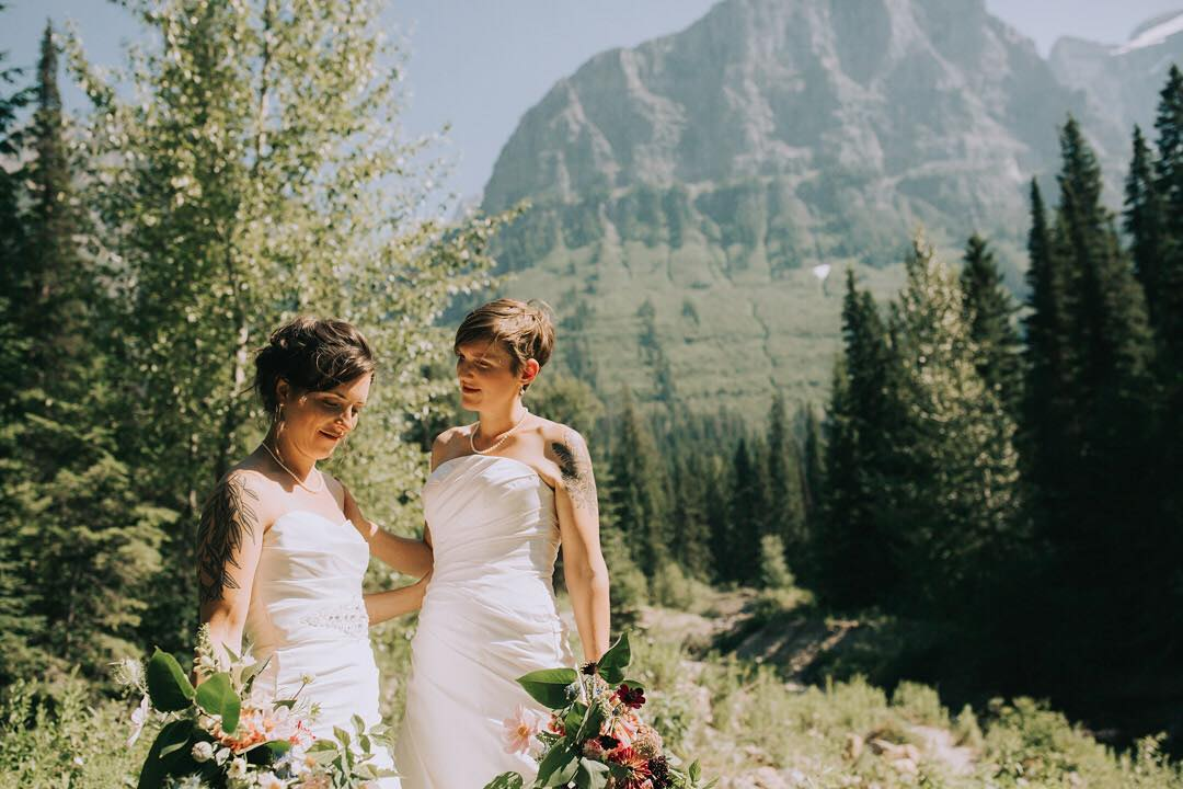 backcountry wedding photographer captures two brides by landscape