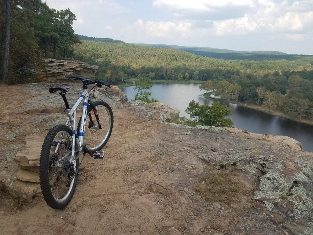 mountain bike at edge of cliff overlooking robbers cave state park