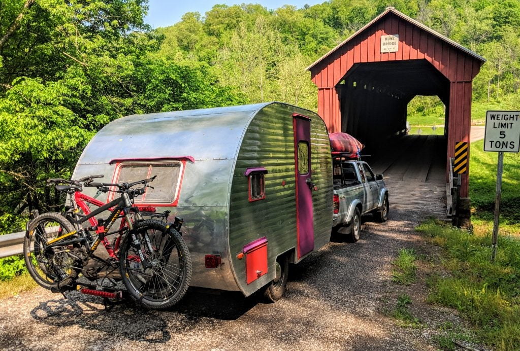 canned ham camper trailer driving across old bridge