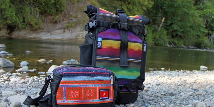 stylish camera bag from ethnotek on a riverbank