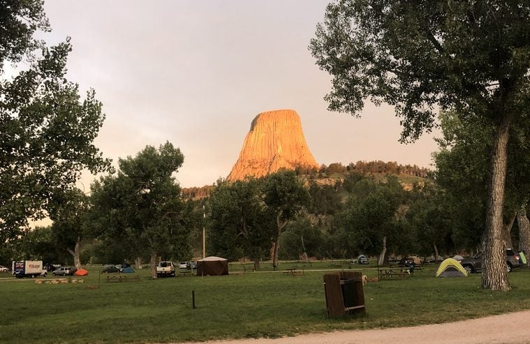 devils tower camping at sunset