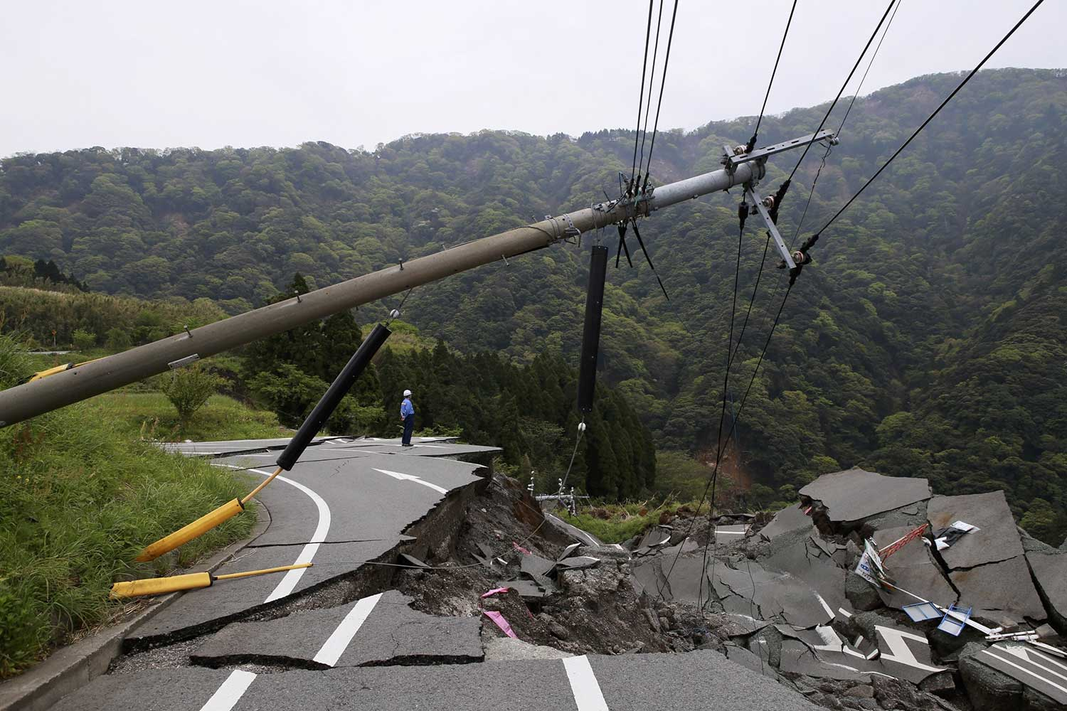 landslide wipes out freshly paved road and powerlines