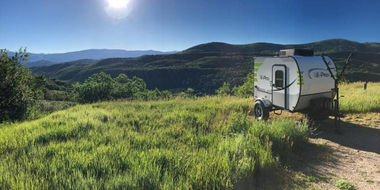micro travel trailers in a field from nature dens