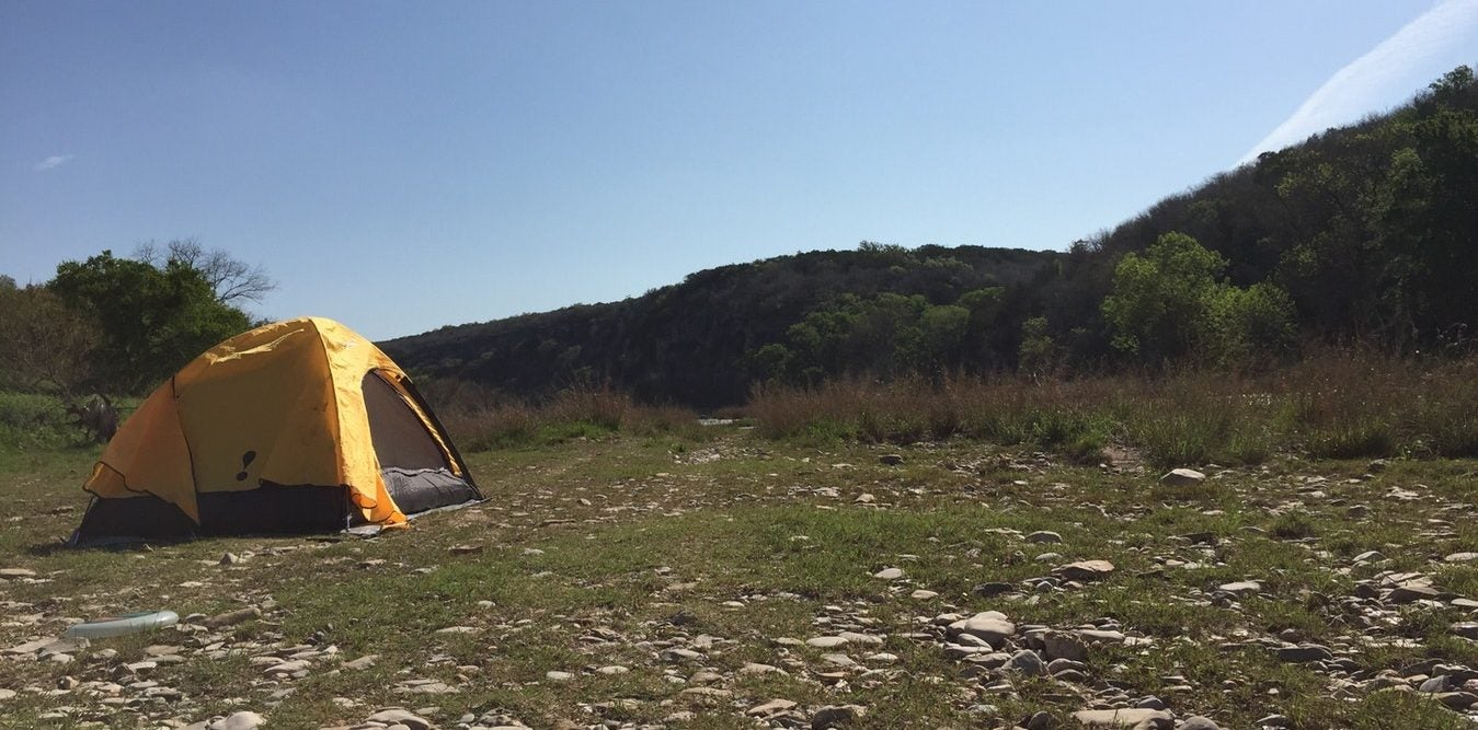 yellow tent pitched in colorado bend state park