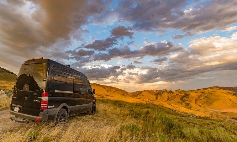 Black mercedes sprinter van in the hills of Montana