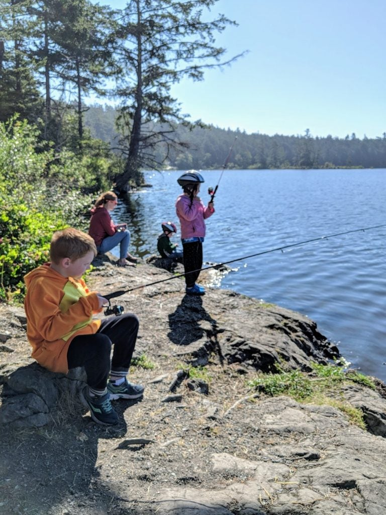 young anglers cast their rods in the waters of deception pass state park