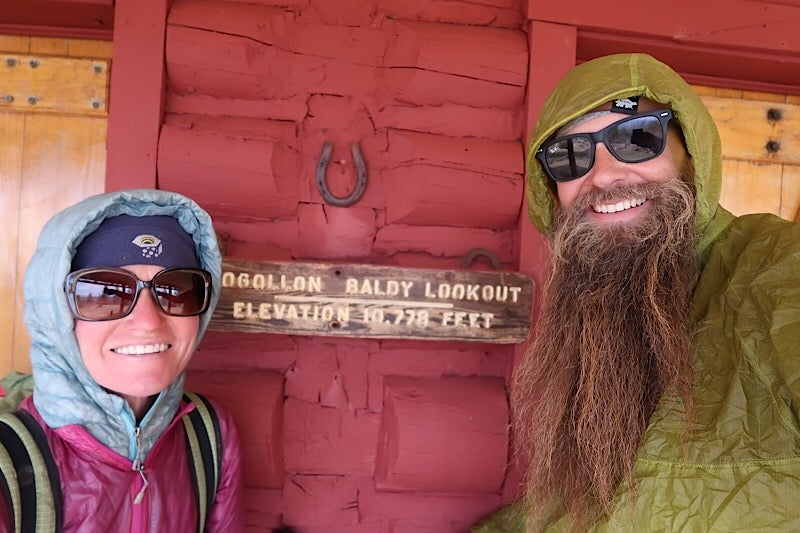 two hikers pose in front of baldy lookout sign