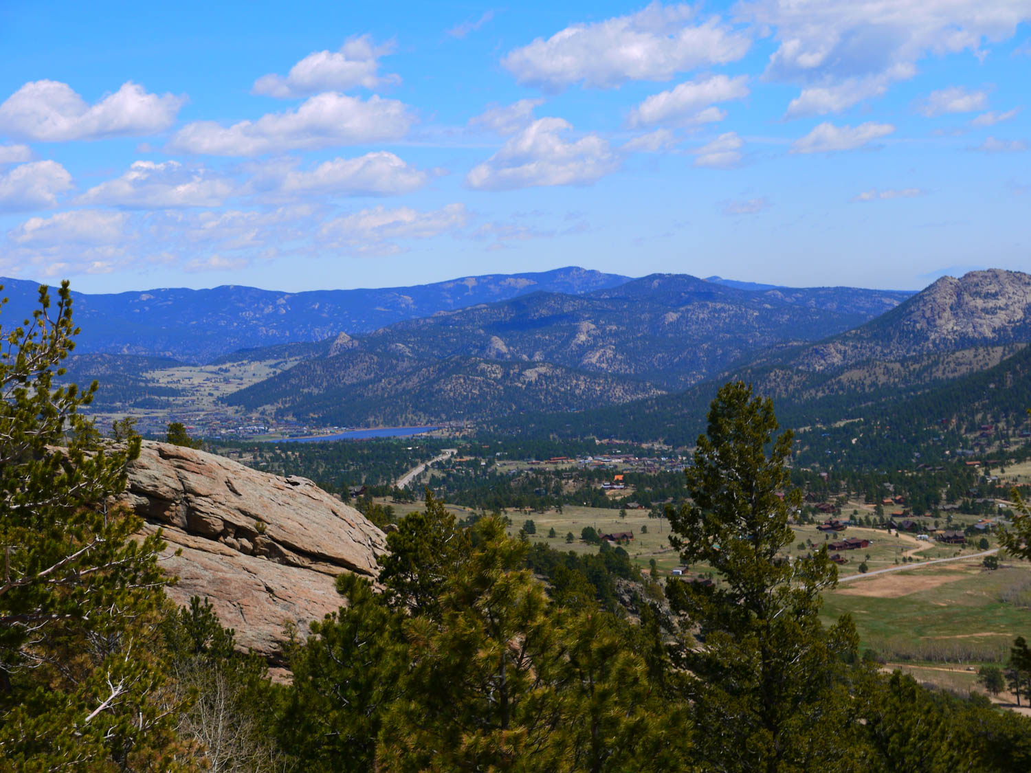 panoramic view of valley beyond longs peak on a clear day