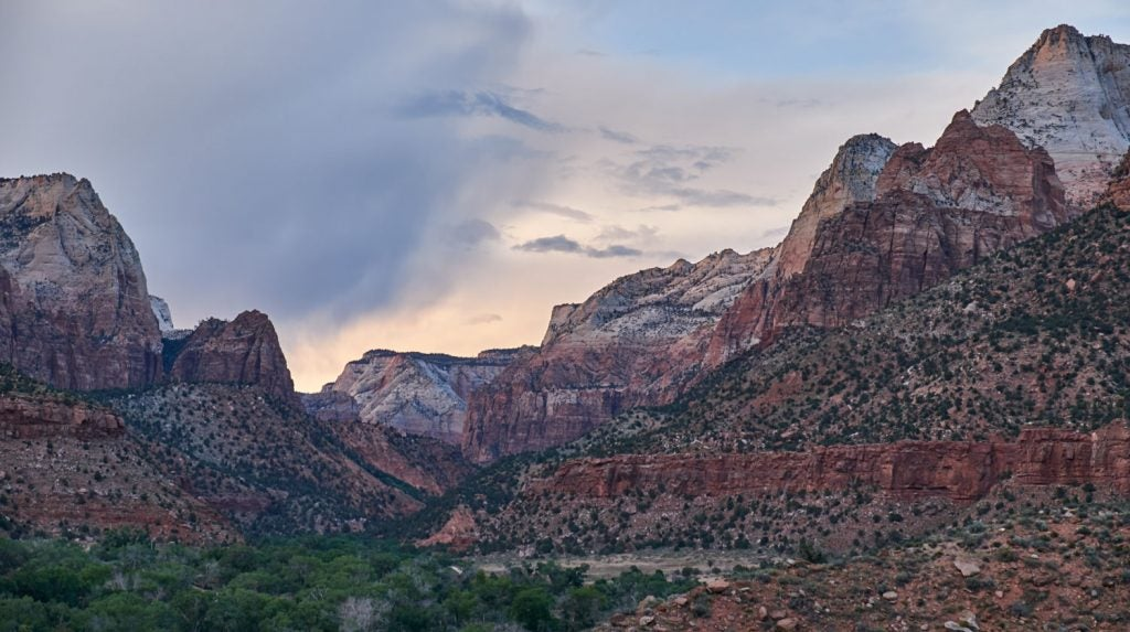the Watchman Trail features rocky mountain walls that form the zion canyon
