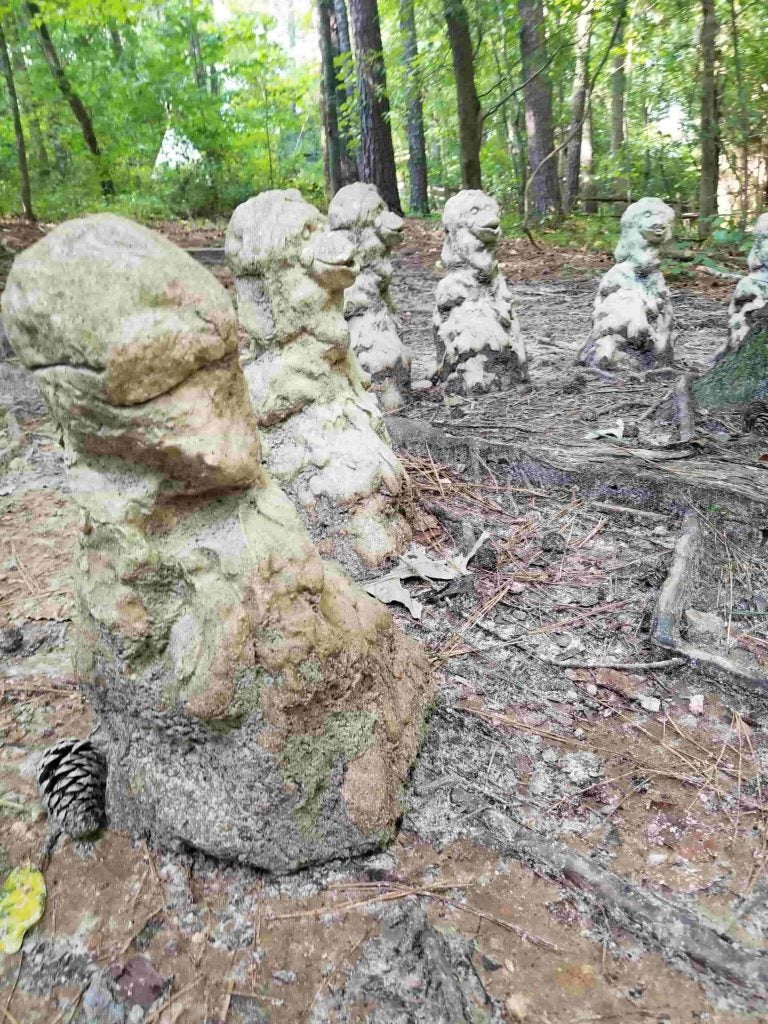 monkey massacre memorial statues along the forest trail