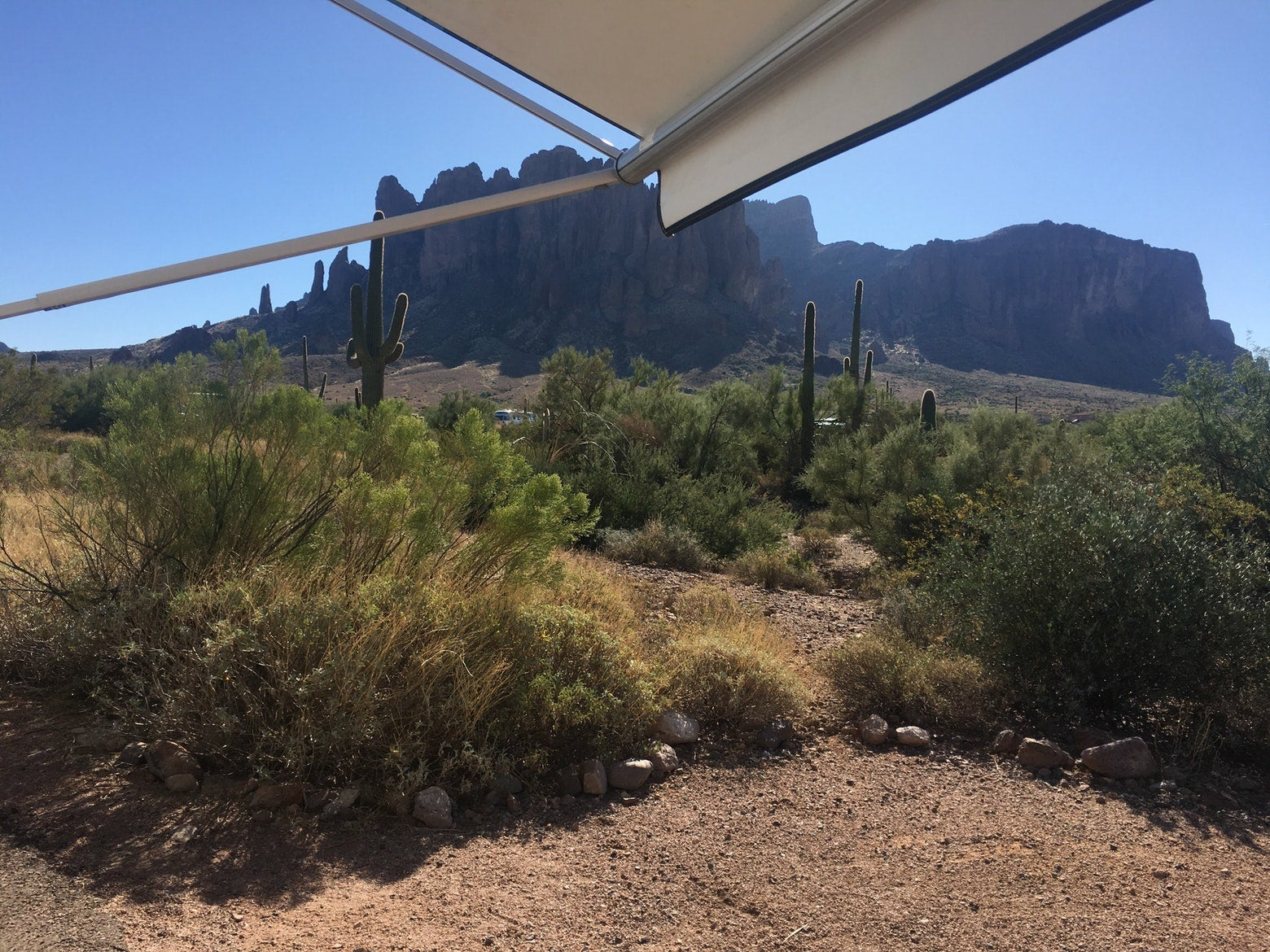 shrubby desert view from under an RV's canopy at lost dutchman state park