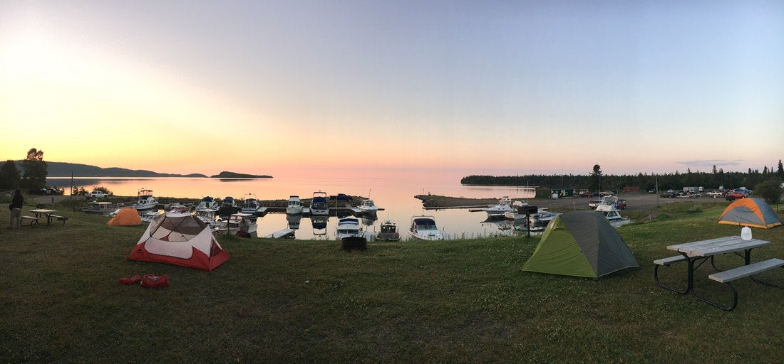 Image of National Parks in Minnesota with tents beside a great lake coast.