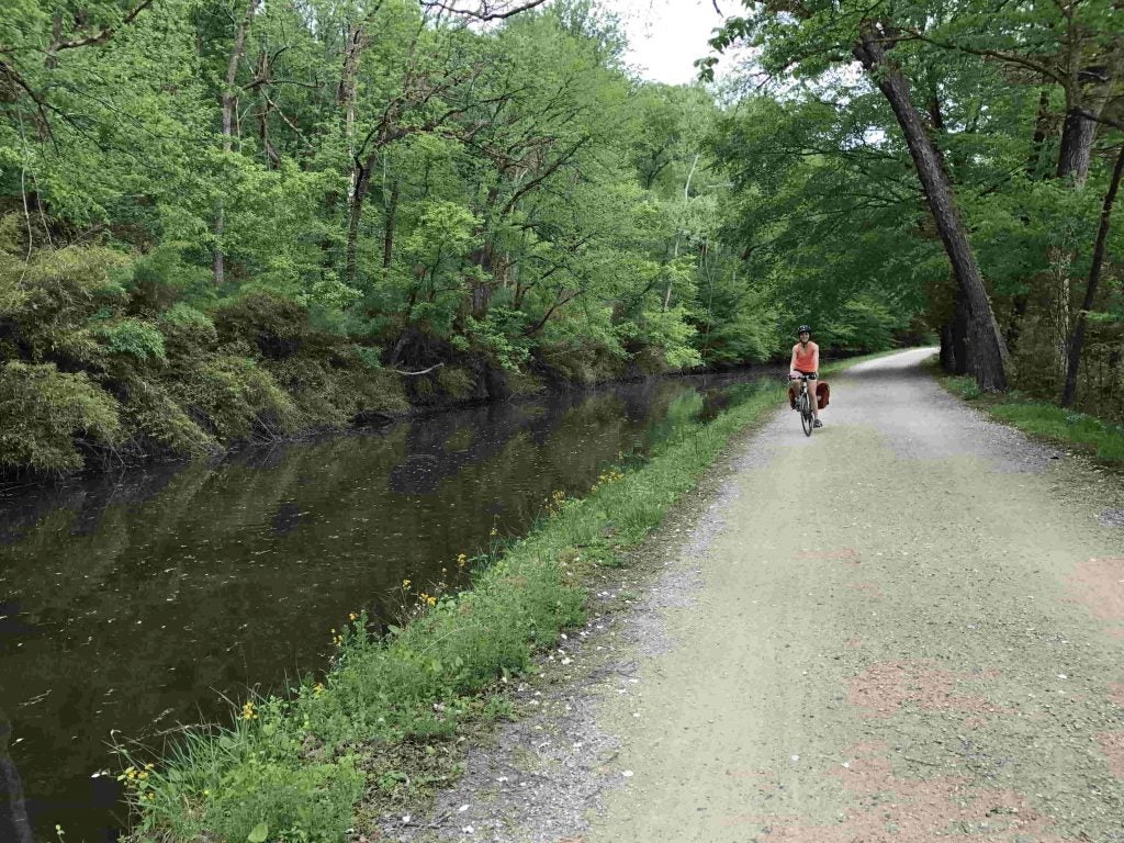 biking along the river on the c&o canal towpath