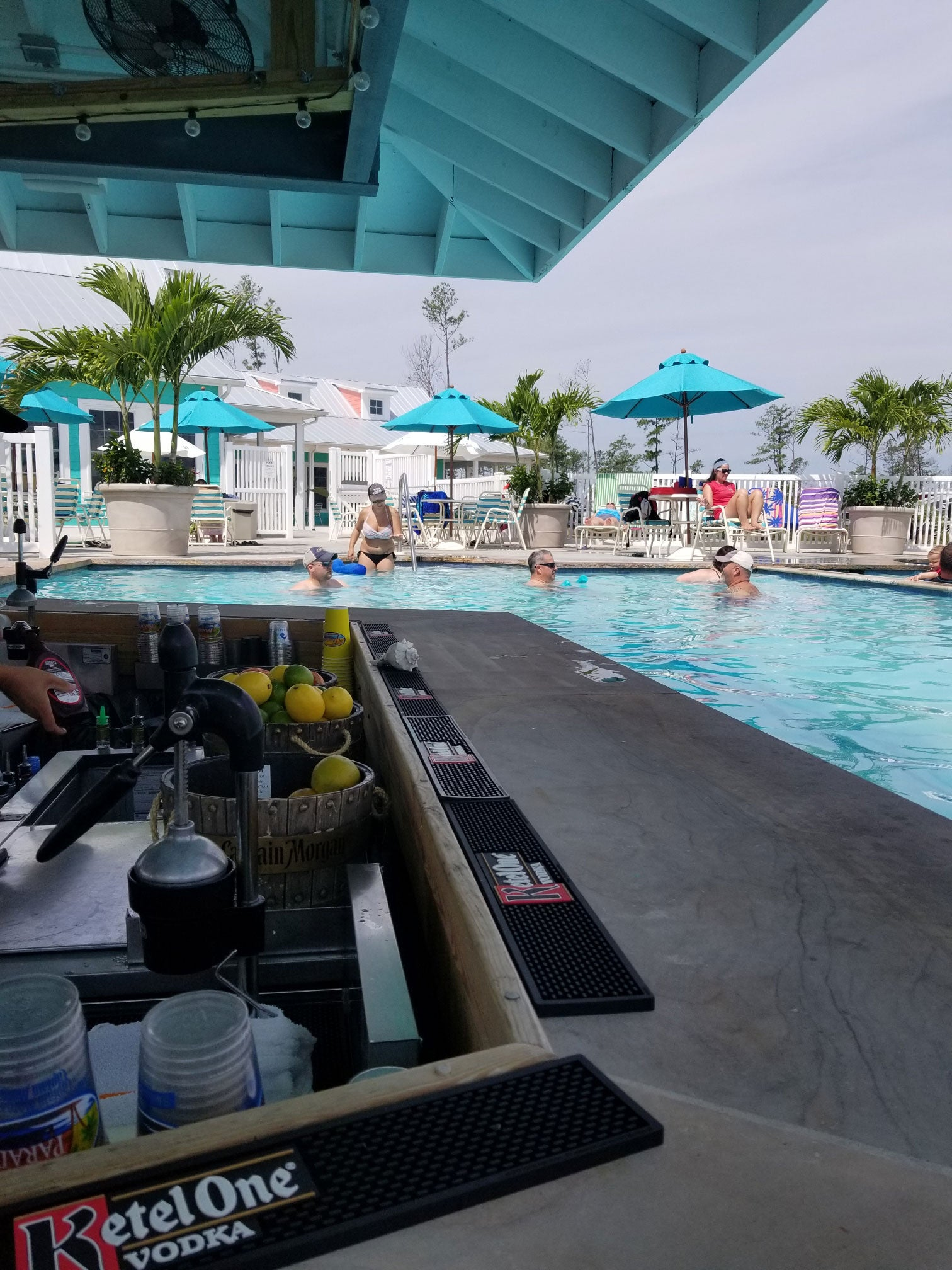 Swimming in the Caribbean-inspired pool with a swim-up bar at Massey's Landing