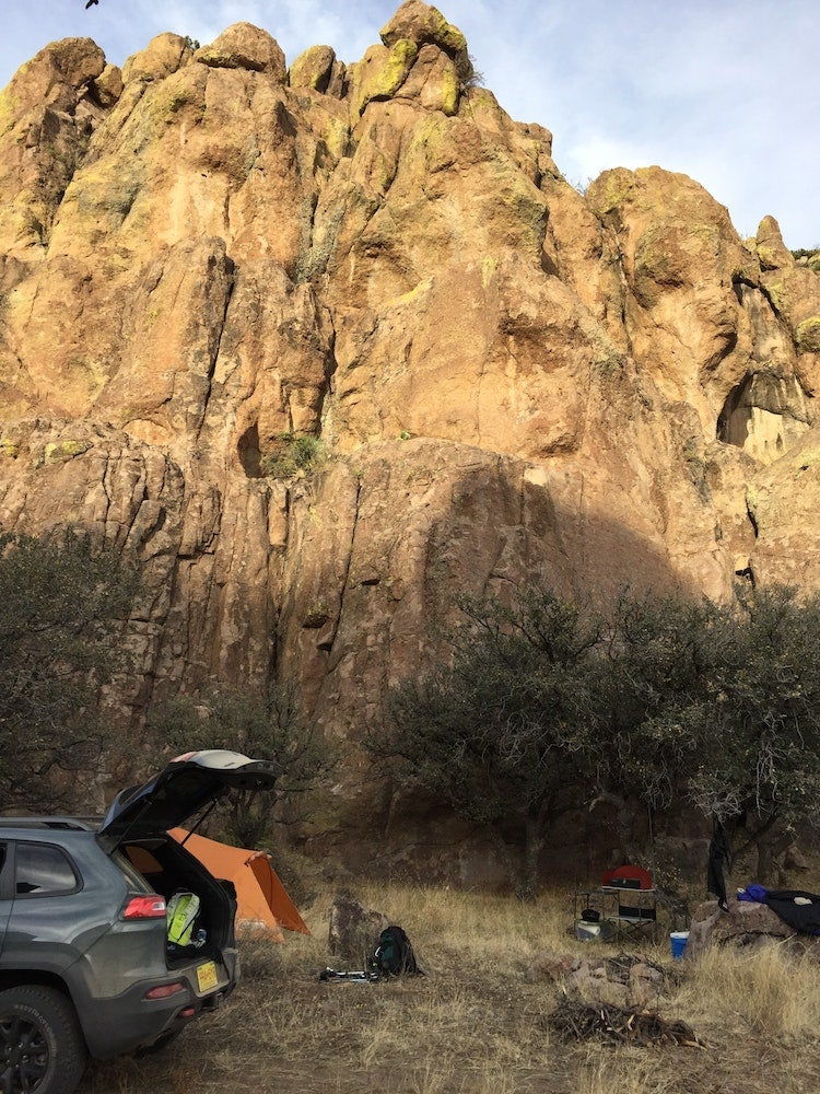 suv with its trunk open below large rock formations at luna park campground