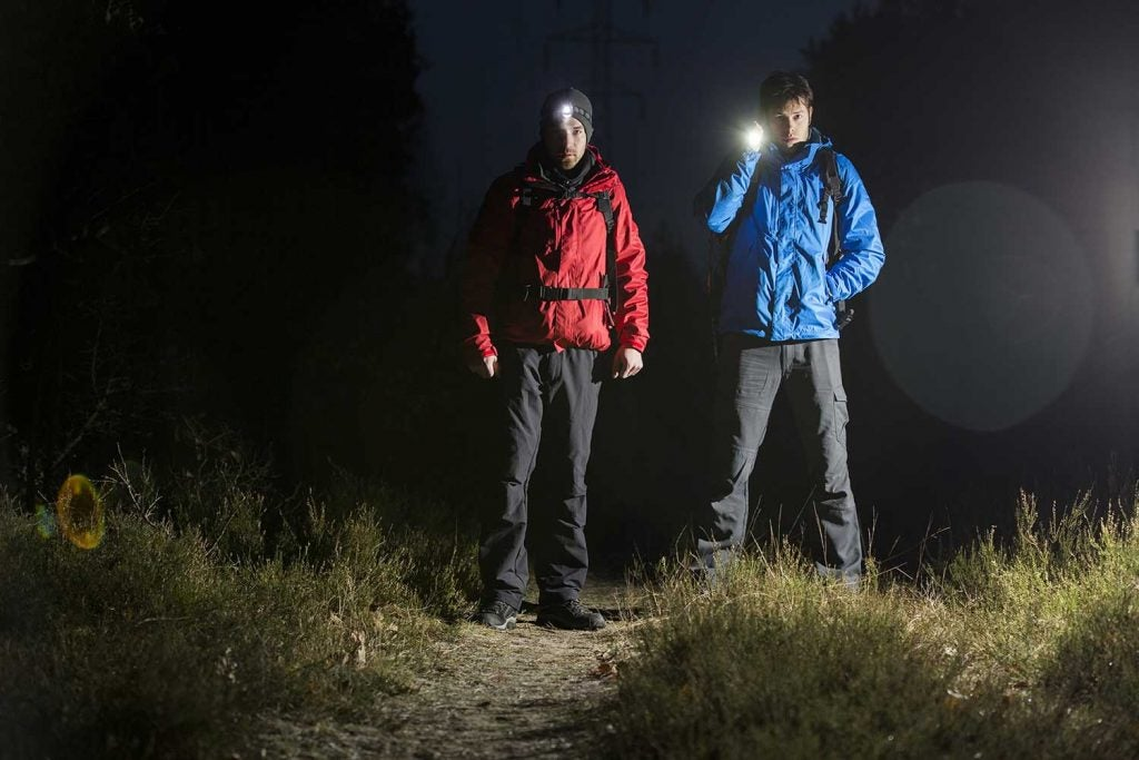 two hikers at night embark on haunted trails