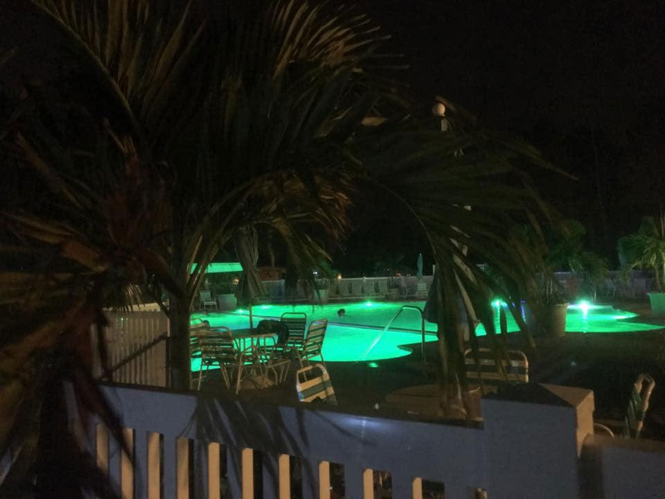 the pool at massey's landing illuminated at night
