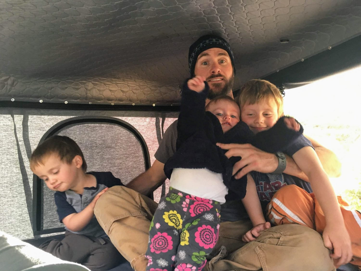 Fitting a dad and three kids in the Roofnest hard shell rooftop tent