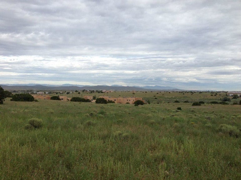 panormaic view of santa fe skies rv park on a cloudy day