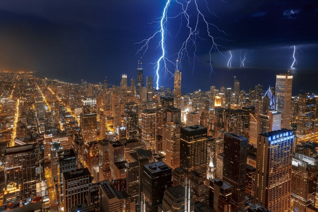 lightning strikes chicago skyline at night