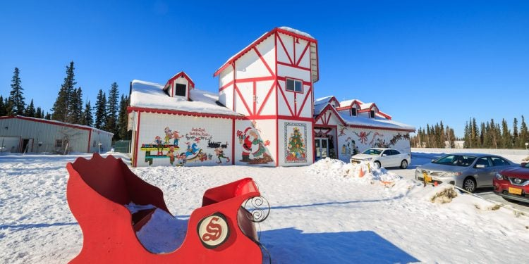 Red sled in front of Santa's Workshop at North Pole, Alaska