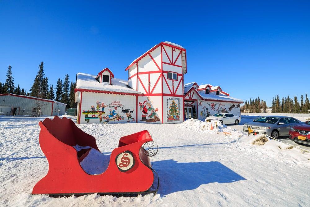 Red sled in front of Santa's Workshop at North Pole, Alaska
