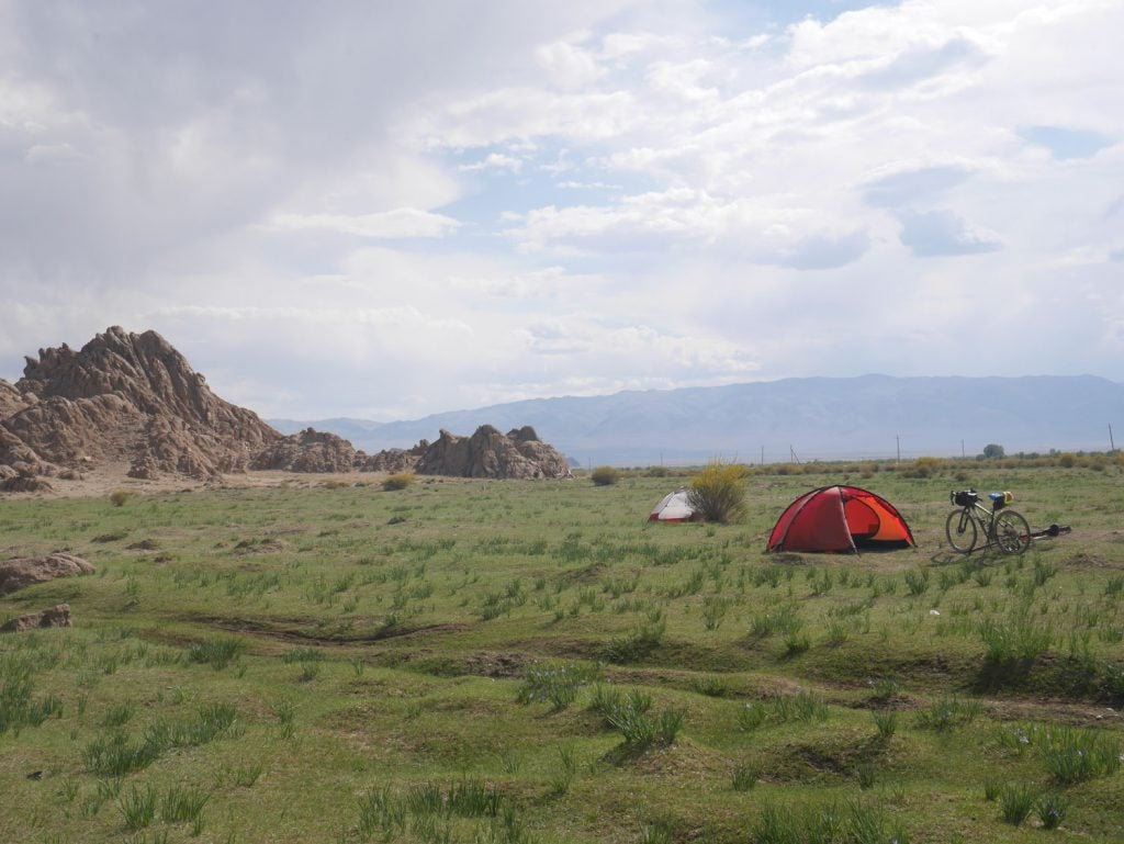 a tent rests in an open field