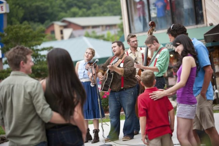 a group of bluegrass musicians play for a crowd