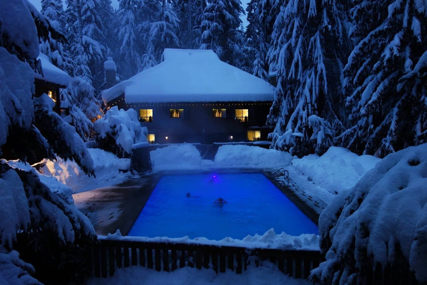 snowy scene overlooking heated pool at alta crystal resort
