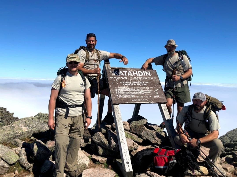 4 military veterans at Katahdin the northern terminus of the appalachian trail