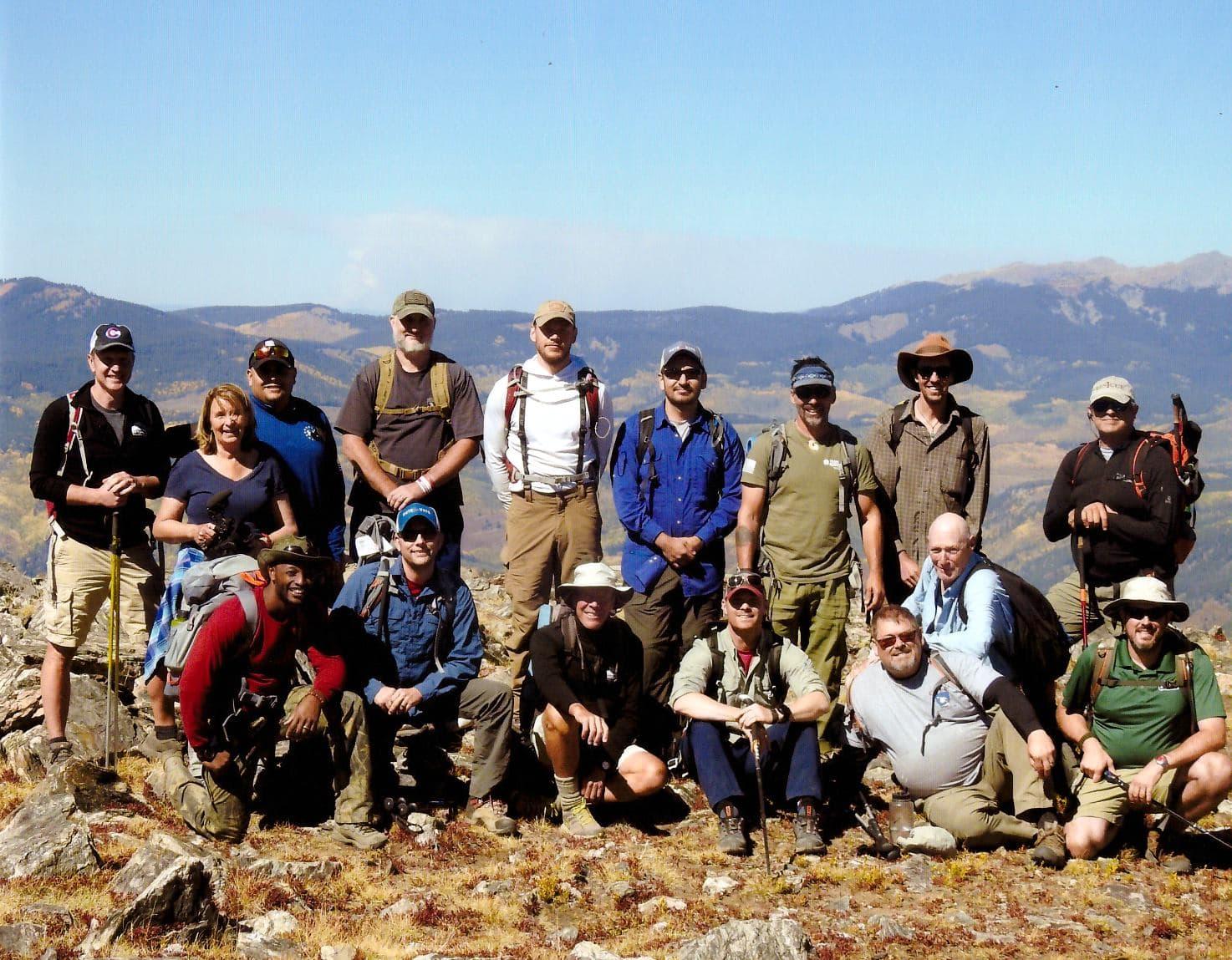 group of veterans on top of mt yeckel near aspen colorado