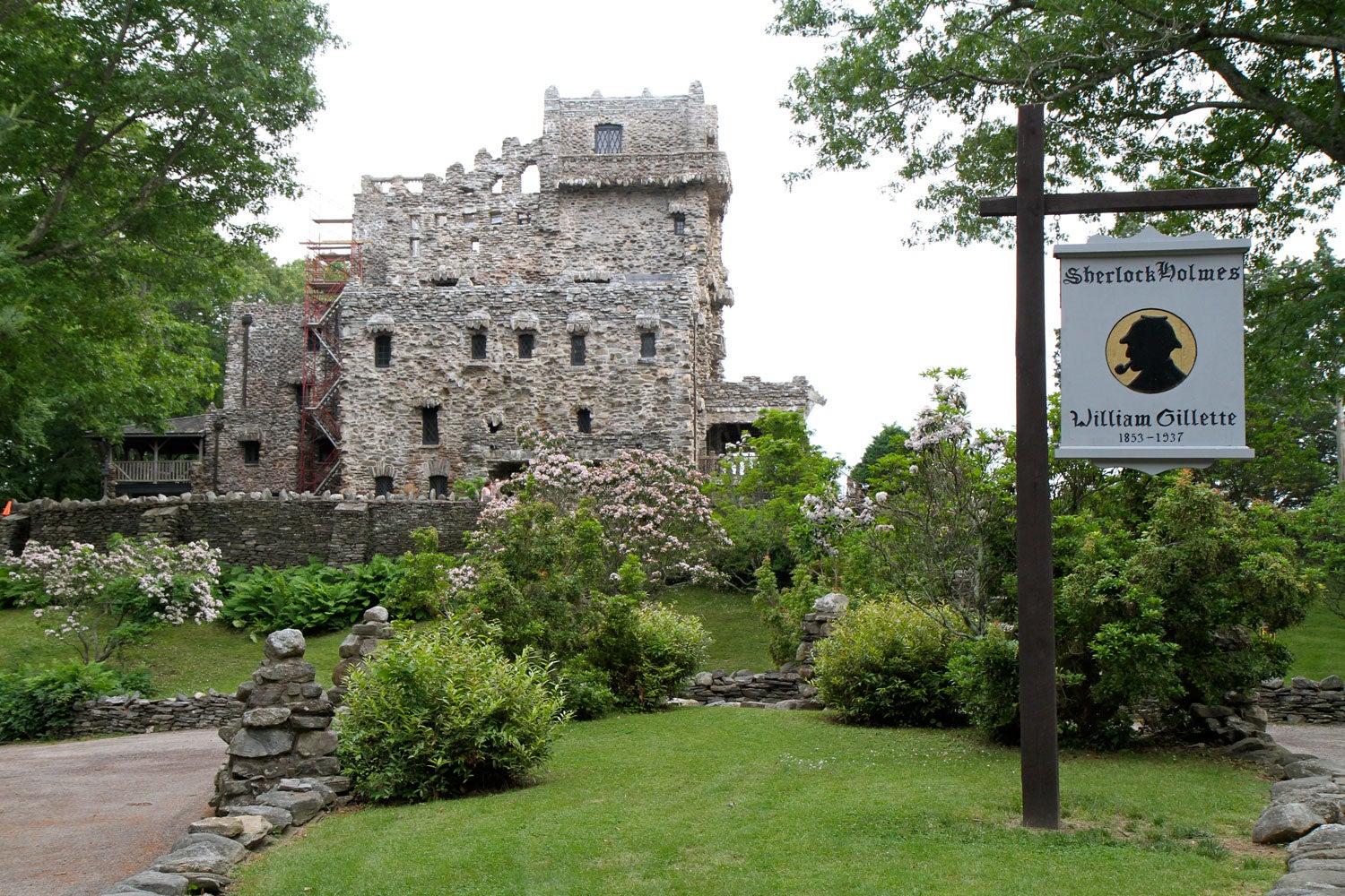 side view of gillette castle grounds, featuring memorial for william gillette
