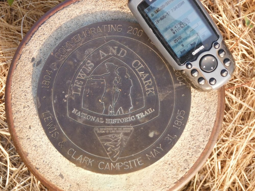 handheld garmin GPS resting on plaque at Lewis and Clark Trail