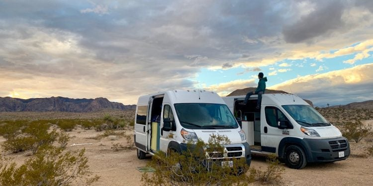 campervans in the desert before sunset