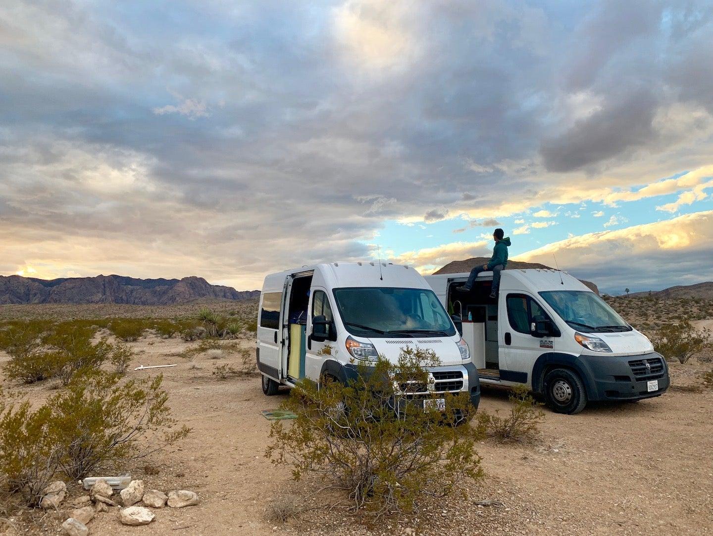 campervans in the desert before sunset
