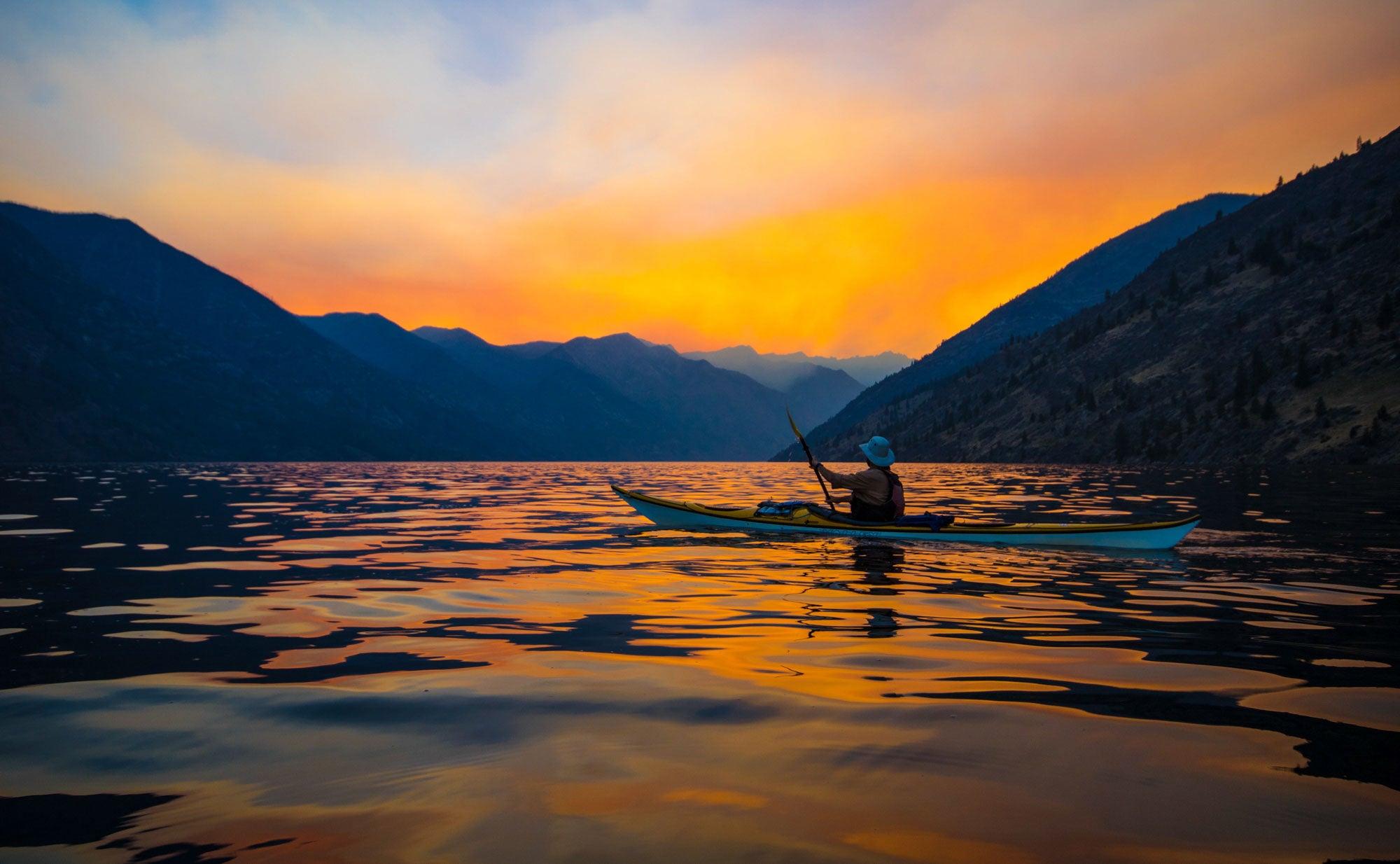 Kayaker floats on Lake Chelan, in washington state